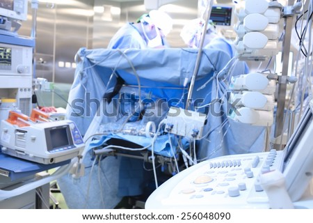 Teamwork in operating room during surgery - stock photo
