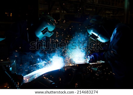 Teamwork in various forms of welding skills up. - stock photo