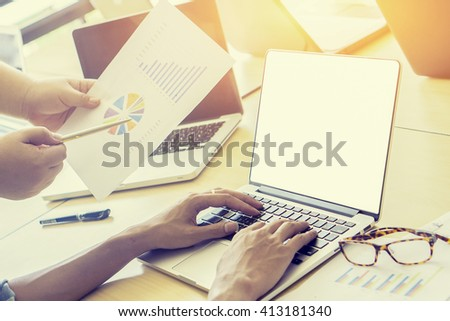 Teamwork of account manager project work.business managers working with new startup in office.Analyze reports,plans. Notebook on wood table, papers, documents, statistics.selective focus,vintage color - stock photo
