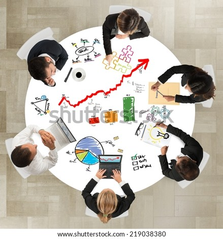 Teamwork of businesspeople works on successful projects - stock photo