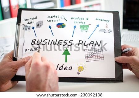 Teamwork on a business plan - stock photo
