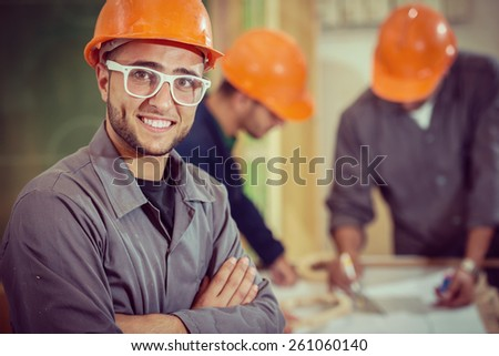 Teamwork on project in factory - stock photo