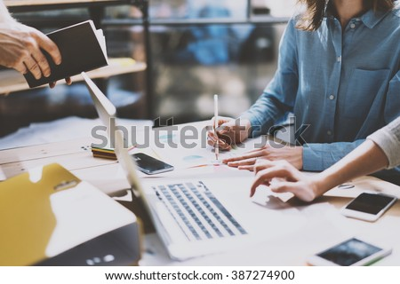 Teamwork. Photo young businessmans crew working with new startup project. Generic design notebook on wood table.  Analyze plans, pencil hands, keyboard. Blurred background, film effect - stock photo