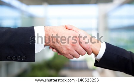 Teamwork shaking hands at the office