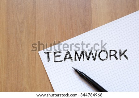 Teamwork text concept write on notebook with pen - stock photo