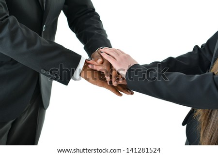 Teamwork with hands together - stock photo