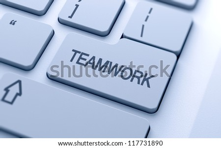 Teamwork word button on keyboard with soft focus