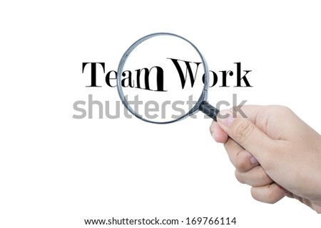 Teamwork word in Magnifying glass business background  - stock photo