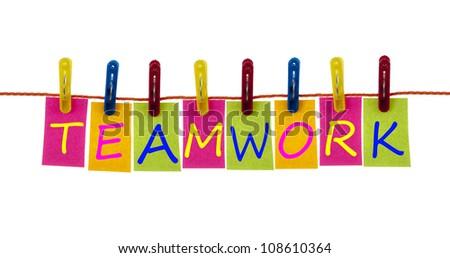 Teamwork word on laundry hook on white - stock photo