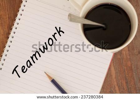 teamwork word write on book  - stock photo