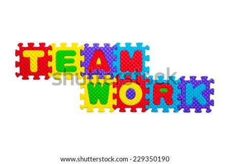 TEAMWORK words made out of alphabet puzzle pieces isolated on white - stock photo