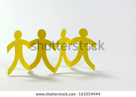 teamwork, yellow paper people on white