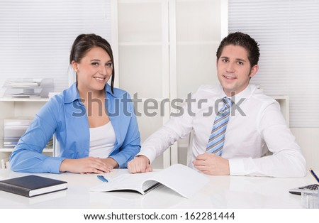 Teamwork - young business colleagues in a meeting discussing - stock photo