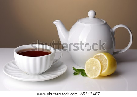 teapot and cup of tea with lemon
