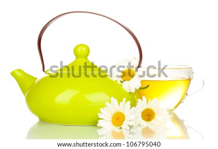 Teapot and cup with chamomile tea isolated on white - stock photo