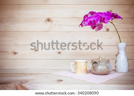 Teapot and flower, home decoration concept - stock photo