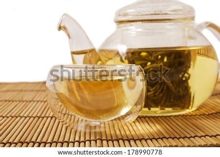 Teapot and glass cups with the chinese jasmine tea Mo Li Long Zhu(Jasmine Pearls) isolated on white background  - stock photo