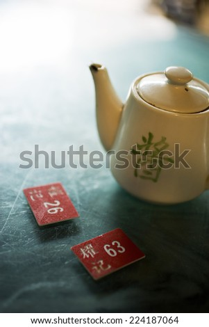 Teapot and table markers - stock photo