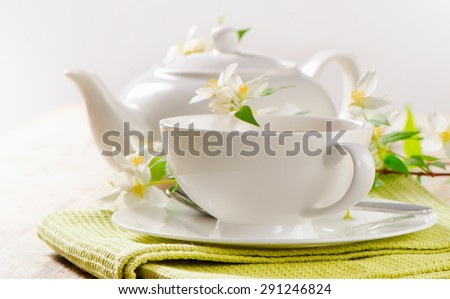 Teapot and teacup of Jasmine tea . Selective focus