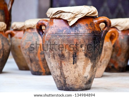 Teapot, tadjin, vase and other products of the Moroccan potter's factories - stock photo