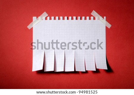 Tear off paper notice on the wall - stock photo