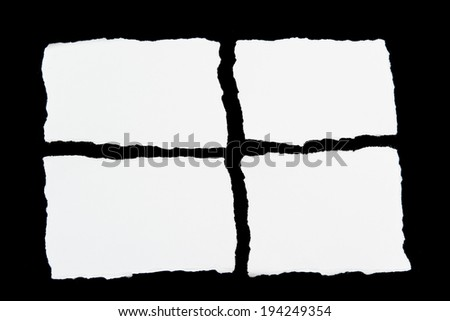 tear white paper pieces of paper on black background - stock photo