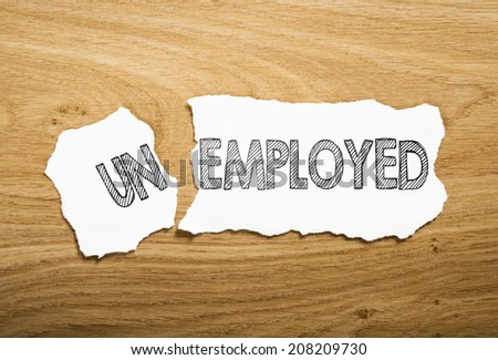 teared paper with text unemployed or employed - stock photo