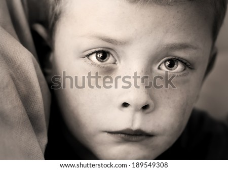 tearful small boy with a look of true sadness - stock photo