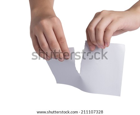 Tearing paper over white background