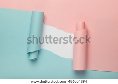 Tears in blue and pink paper revealing white background underneath