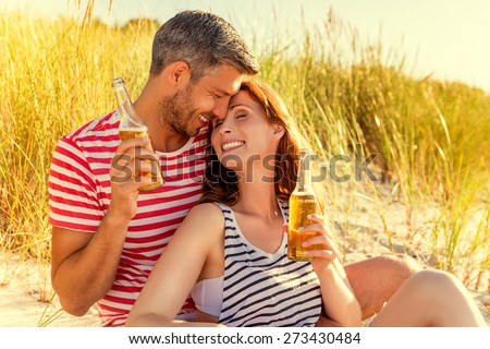 teasing boyfriend and girlfriend laying down - stock photo
