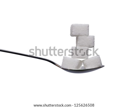 Teaspoon with sugar cubes on white background - stock photo