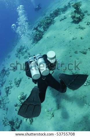 Tech diver dives with twin tanks - stock photo