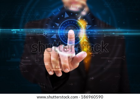 Tech guy pressing high technology control panel screen concept  - stock photo