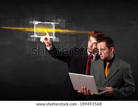 Tech people touching button with orange light beams concept  - stock photo