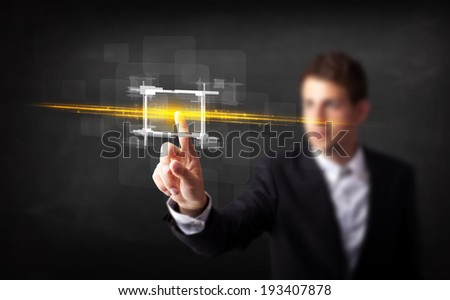 Tech person touching button with orange light beams concept