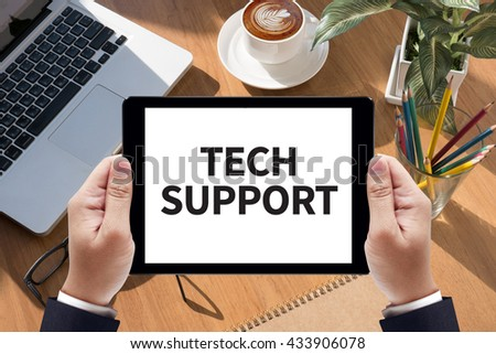 TECH SUPPORT Businessman work  on tablet on screen - stock photo