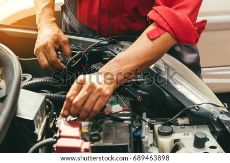 technicain checking car fuse by lamp stock photo royalty free rh shutterstock com  car fuse box test