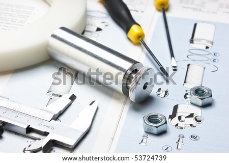 technical drawings with tools and parts - stock photo