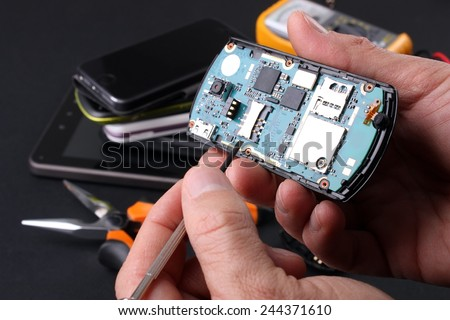 Technical repair phone - stock photo