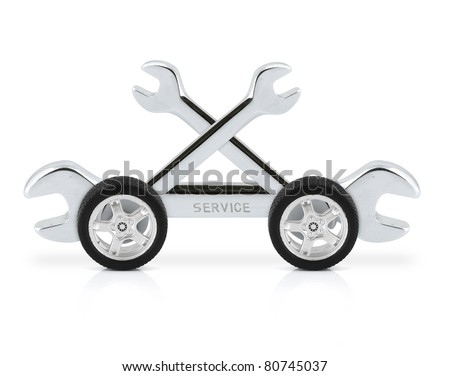 technical service concept, wrench on car wheels - stock photo