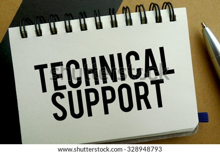 Technical support memo written on a notebook with pen