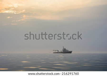Technical vessel in the mist - stock photo