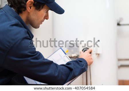 Technician adjusting a regulator - stock photo