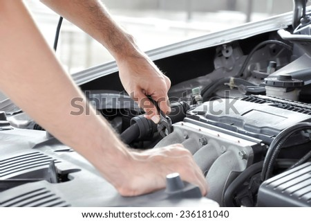 Technician checking  car engine - stock photo