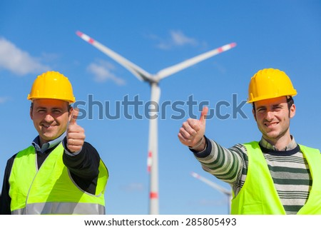 Technician Engineers Thumbs Up with Wind Power Generator