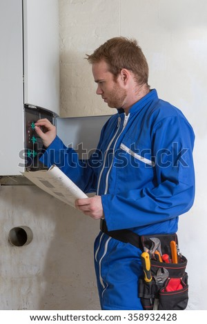 Technician  for heating system - stock photo