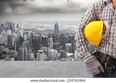 technician half body and urban scene balcony over looking city dusky before rain falling - stock photo