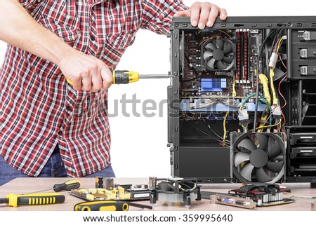 Technician repair assembles computer. Isolated on a white background. - stock photo