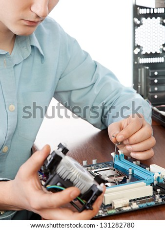 Technician repairing computer hardware in the lab .Small DOF - stock photo